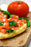 Tomato topped bruschetta Stock Photography