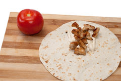 Tomato and tortilla with chicken meat preparing Royalty Free Stock Photo
