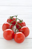 Tomato truss. On a white wooden board Royalty Free Stock Image