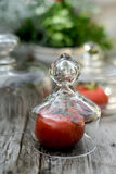 Tomato under a glass cap Stock Images