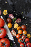 Tomato Varieties on Black Overhead View Royalty Free Stock Images