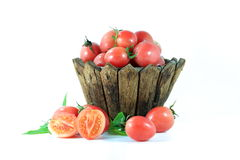 Tomato vegetable. In wooden basket on white background Royalty Free Stock Photo
