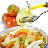 Tomato and vegetable salad dressed with olive oil Stock Photos