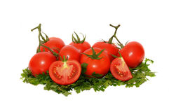 Tomato vegetables and parsley leaves still life isolated on whit Stock Image