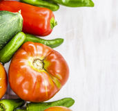 Tomato and vegetables  on white wooden Stock Image