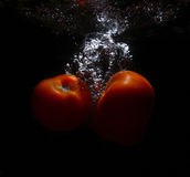 Tomato in the water royalty free stock photography