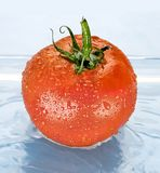 Tomato in water. With drops on sides Stock Photo