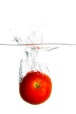 Tomato in water Stock Photos