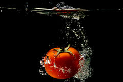 Tomato water splash Royalty Free Stock Photo