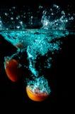 Tomato water splash on black background. Fresh tomato water splash on black background Stock Images