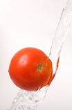 Tomato in water stream Royalty Free Stock Photos