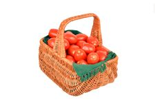 Tomato in a wattled basket Royalty Free Stock Image