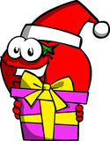 Tomato wearing Santa's hat and holding gift box Stock Images