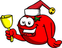 Tomato wearing Santa's hat and playing bell Stock Image