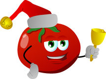 Tomato wearing Santa's hat and playing bell Stock Photo