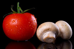 Tomato and white button mushrooms Stock Photography