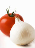 Tomato and white onion. Red fresh tomato and white fresh salad onion Royalty Free Stock Images
