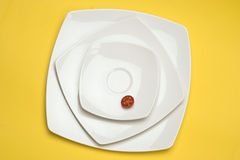 Tomato in white plate Stock Photo