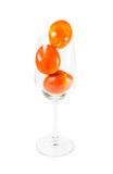 Tomato on wine glass Royalty Free Stock Image
