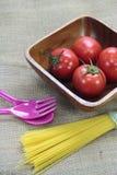 Tomato on wood plate Stock Photo