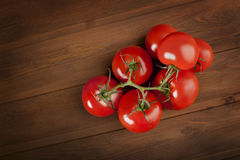Tomato on wood table Stock Photography