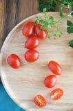 Tomato on wooden background Royalty Free Stock Photos