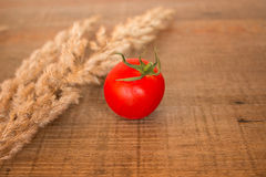 Tomato on a wooden background Royalty Free Stock Image