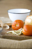 Tomato on wooden board Stock Images