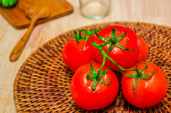 Tomato on wooden board Stock Photography