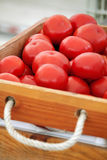 Tomato in wooden box Stock Images