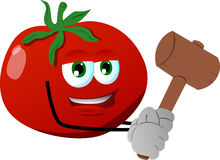 Tomato with a wooden hammer Stock Photos