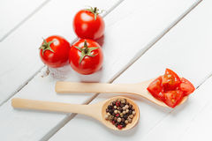 Tomato on wooden spoon Royalty Free Stock Photography