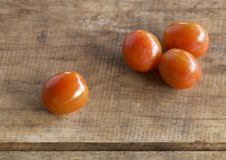 Tomato on wooden table Stock Photo