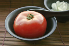 Tomato Zen. Tomato inside a bowl Stock Photo