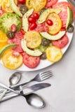 Tomatoe and avocado slices on white Royalty Free Stock Photos