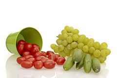 Tomatoe, cucumber and grapes Royalty Free Stock Photography