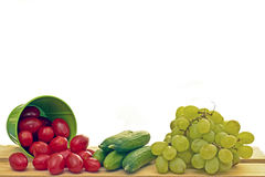 Tomatoe, cucumber and grapes Stock Photography