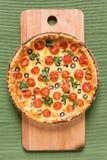 Tomatoe e crostata verde oliva Fotografia Stock