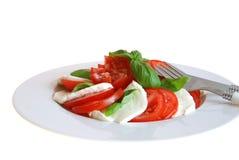 Tomatoe with mozzarella. And basil stock photo