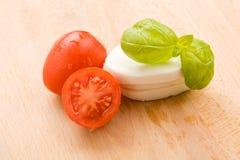 Tomatoe and Mozzarella on Cutting board Stock Images