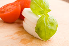 Tomatoe and Mozzarella on Cutting board Stock Image