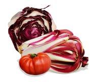 Tomatoe and radicchio. One tomatoe and different types of radicchio of Treviso origins, on white background Stock Images