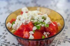Tomatoe sallad med ost Arkivfoton