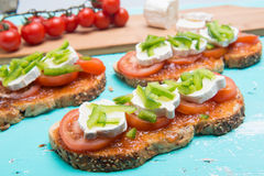Tomatoe sandwich with basil and fresh cheese. And tomatoes marmalade Royalty Free Stock Images