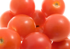 Tomatoes. Detail of a stack of tomatoes against a white background royalty free stock images