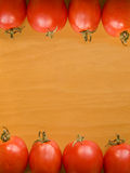 Tomatoes. Photo of tomatoes on the wwoden background. Up view Royalty Free Stock Images