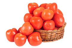 Tomatoes. Pile of tomatoes in a straw basket Royalty Free Stock Photos