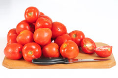 Tomatoes. Pile of tomatoes on a cutting board Royalty Free Stock Photos