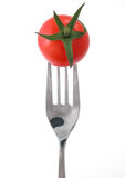 Tomatoes. Against a white background on a fork stock photography