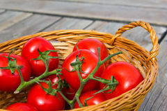 Tomatoes. Photograph of ecological tomatoes placed in a wooden basket Royalty Free Stock Images